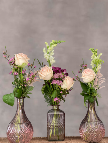 Pink Votive Table Centrepiece with Seasonal Flowers