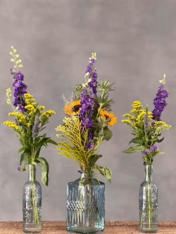 Blue Votive Table Centrepiece with Seasonal Flowers